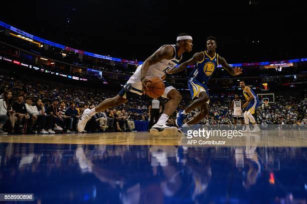 TOPSHOT Minnesota Timberwolves's NBA player Marcus GeorgesHunt dribbles the ball during the NBA Basketball Game between Golden State Warriors and...