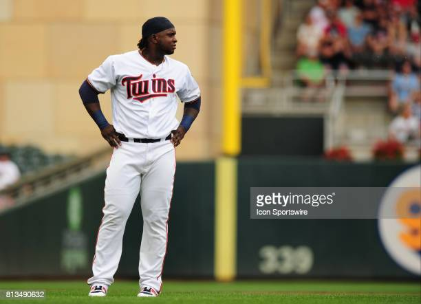 Minnesota Twins batter Miguel Sano waits for his cap and glove after flying out to end the first inning of their Major League Baseball game against...