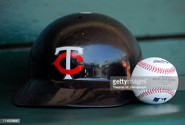 Minnesota Twins batting helmet and Official Major League Baseballs in the dugout of the Minnesota Twins before a MLB baseball game against the...