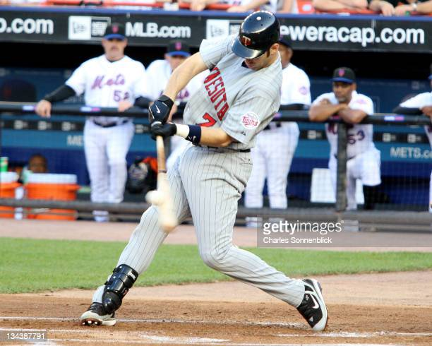 Minnesota Twins catcher Joe Mauer connects for a base hit against the New York Mets on June 18 2007 at Shea Stadium in Queens New York