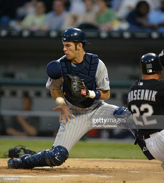 Minnesota Twins catcher Joe Mauer takes throw from centerfielder Torii Hunter during the game against the Chicago White Sox at US Cellular Field in...