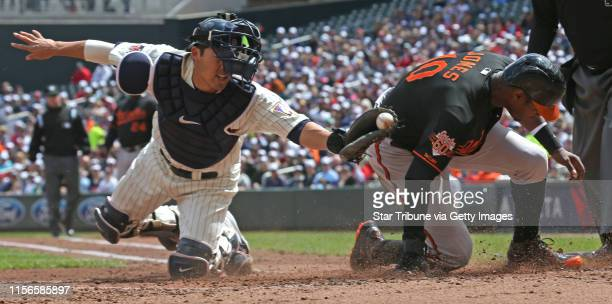 Minnesota Twins catcher Kurt Suzuki couldn't make the tag as Baltimore's Adam Jones scored in 2nd inning action at Target Field on 5/3/14.] Bruce...