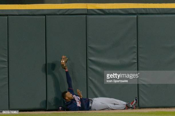 Minnesota Twins Center field Byron Buxton lays on the ground near the outfield wall after catching a fly ball off the bat of Chicago White Sox...