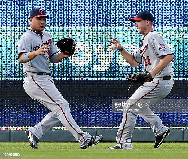 Minnesota Twins center fielder Clete Thomas chases down the ball in front of left fielder Oswaldo Arcia on a single by Kansas City Royals designated...