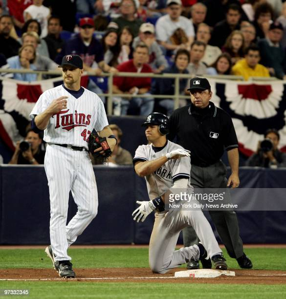 Minnesota Twins' Corey Koskie stands by as New York Yankees' Alex Rodriguez brushes himself off after stealing third base in the 11th inning of Game...