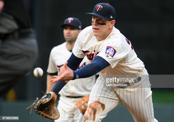 Minnesota Twins Designated hitter Logan Morrison flips the ball to 1st during a MLB game between the Minnesota Twins and Boston Red Sox on June 20...