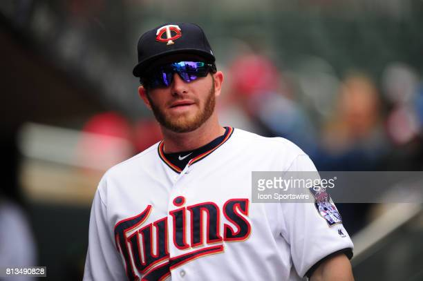 Minnesota Twins designated hitter Robbie Grossman looks on from the dugout before the start their Major League Baseball game against the Baltimore...