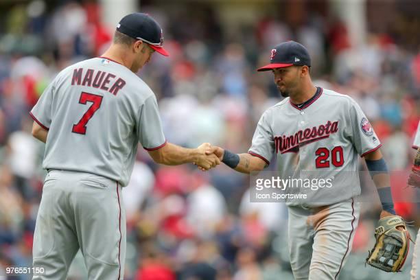 Minnesota Twins first baseman Joe Mauer and Minnesota Twins left fielder Eddie Rosario celebrate following the Major League Baseball game between the...
