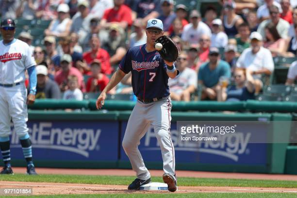 Minnesota Twins first baseman Joe Mauer makes a putout at first base during the first inning of the Major League Baseball game between the Minnesota...
