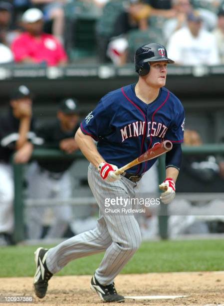 Minnesota Twins' first baseman, Justin Morneau, lines a 9th inning double during their game against the Chicago White Sox August 27, 2006 at U.S....