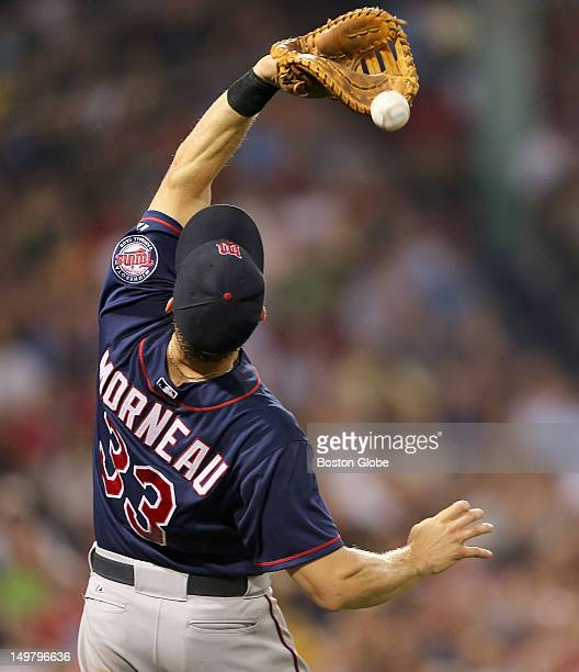 Minnesota Twins first baseman Justin Morneau misplayed the catch of a pop foul ball hit by Boston Red Sox left fielder Carl Crawford , not pictured,...