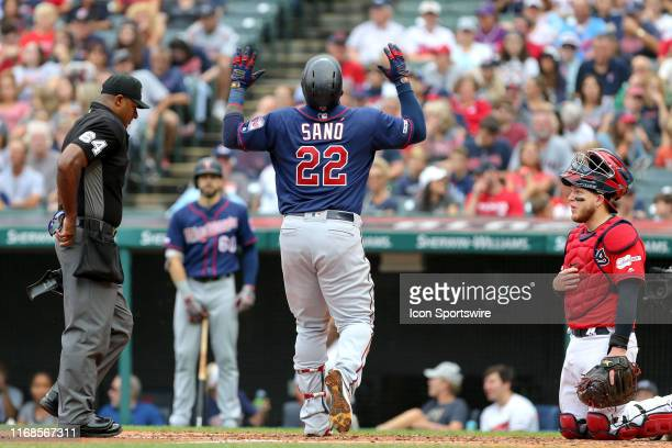 Minnesota Twins infielder Miguel Sano celebrates as he crosses the plate after hitting a home run during the third inning of the Major League...