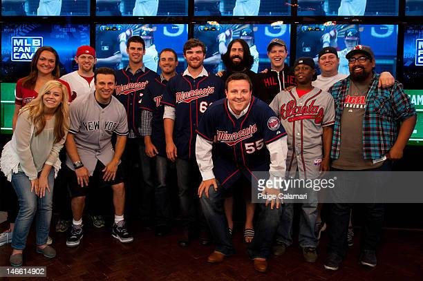 Minnesota Twins Joe Mauer Brian Duensing Liam Hendriks and Matt Capps pose with the Cave Dwellers during their visit at the MLB Fan Cave Wednesday...