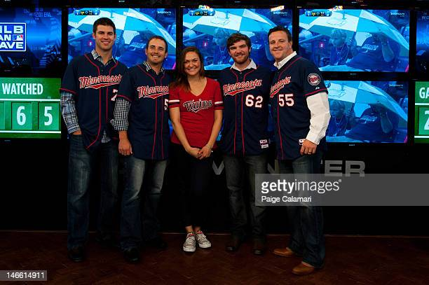 Minnesota Twins Joe Mauer Brian Duensing Liam Hendriks and Matt Capps pose with Cave Dweller Lindsay Guentzel during their visit to the MLB Fan Cave...