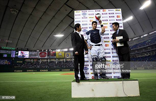 Minnesota Twins' Joe Mauer tips his cap to the crowd as he is named the MVP of Game 2 of the 2006 Japan All-Star Series at the Tokyo Dome. The MLB...