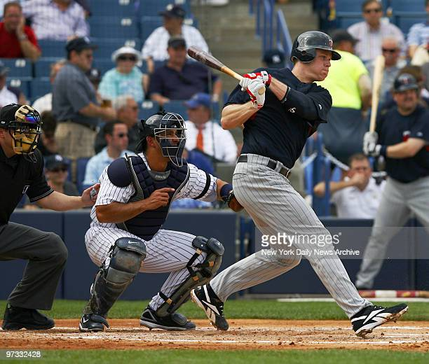 Minnesota Twins' Justin Morneau hits a grounder early in a spring training game against the New York Yankees at Legends Field