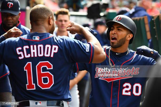 Minnesota Twins left fielder Eddie Rosario celebrates a home run with Minnesota Twins second baseman Jonathan Schoop during a MLB game between the...