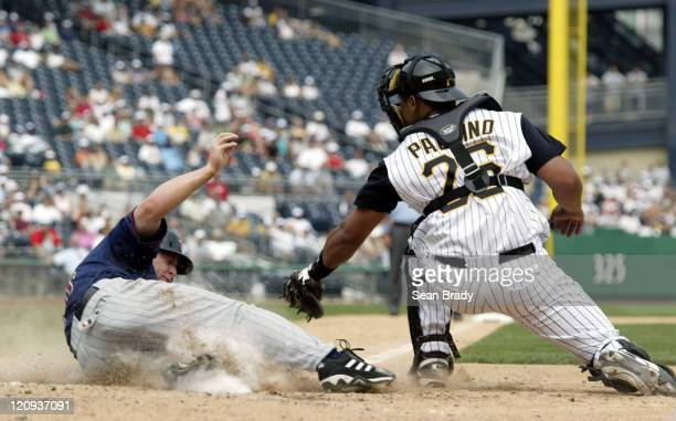Minnesota Twins Lew Ford beats the tag by Pittsburgh's Ronny Paulino wide to score during action at PNC Park in Pittsburgh Pennsylvania June 18 2006...