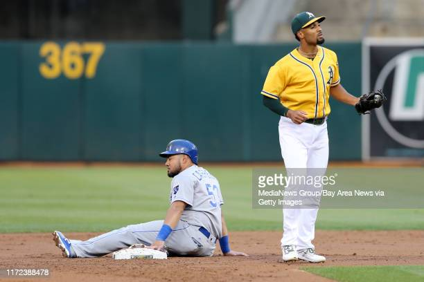 Minnesota Twins' Melky Cabrera rests at second after he was tagged out by Oakland Athletics' Marcus Semien on his attempt too steal in the first...