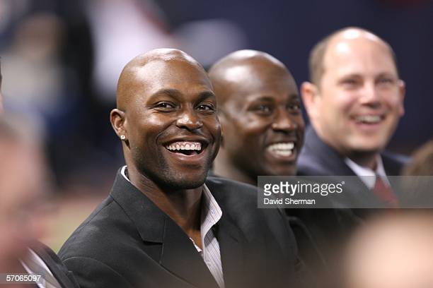 Minnesota Twins outfielder Torii Hunter laughs at a replay of Kirby Puckett's reading of David Letterman's Top 10 List at the public memorial service...