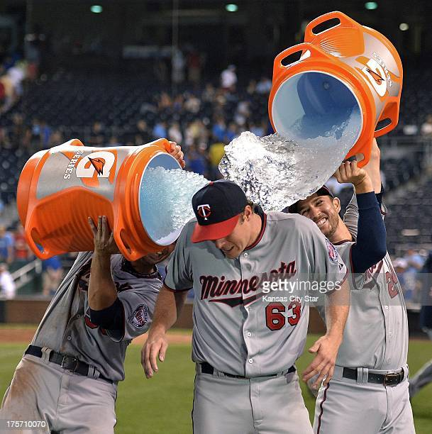 Minnesota Twins pitcher Andrew Albers receives a surprise bath from teammates Chris Colabello and Trevor Plouffe after Albers won in his major league...