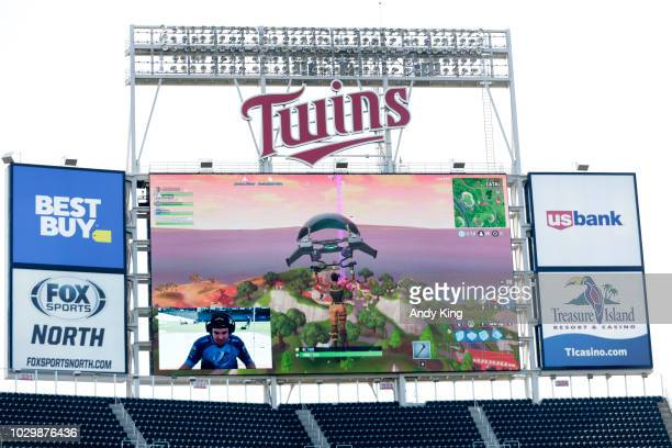 Minnesota Twins pitcher Trevor May plays the video game Fortnite with the live game projected on the stadium screen before the Minnesota Twins play...