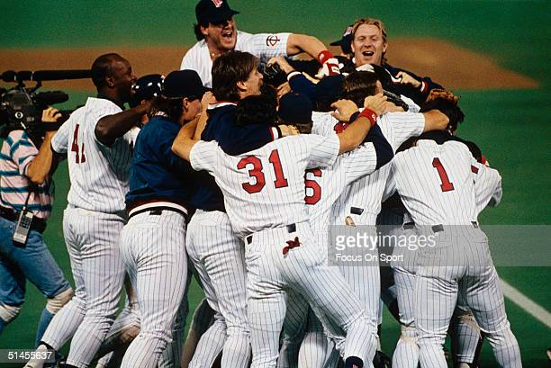 Minnesota Twins players celebrate after winning Game Seven of the 1991 World Series against the Atlanta Braves at the Metrodome on October 27 1991 in...