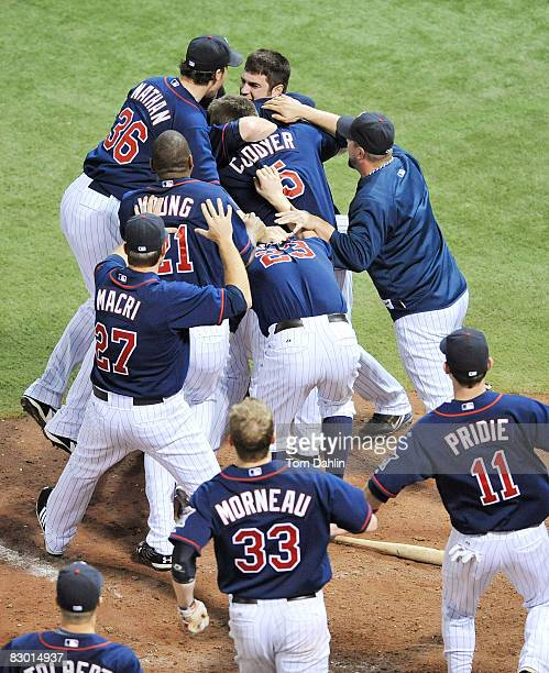 Minnesota Twins players celebrate following a Twins win against the Chicago White Sox at the Hubert H. Humphrey Metrodome September 25, 2008 in...