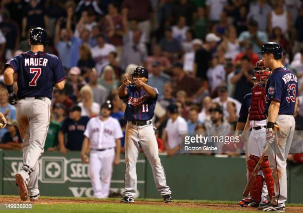 Minnesota Twins relief pitcher Glen Perkins points to Minnesota Twins catcher Joe Mauer after his three run home run won the game in the ninth...