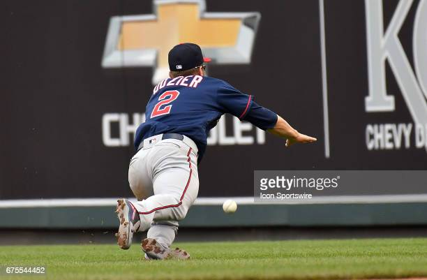 Minnesota Twins second baseman Brian Dozier can't handle a ball hit to right field by Kansas City Royals catcher Salvador Perez in the fourth inning...