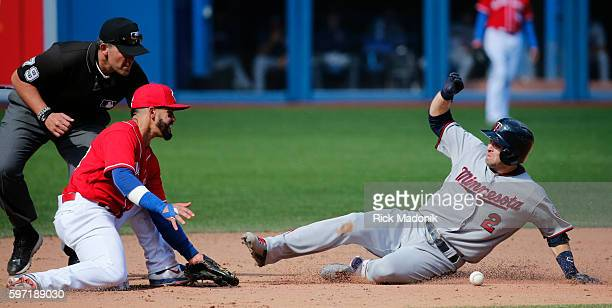 Minnesota Twins second baseman Brian Dozier gets into 2nd base as Toronto Blue Jays second baseman Devon Travis can't handle the throw Toronto Blue...