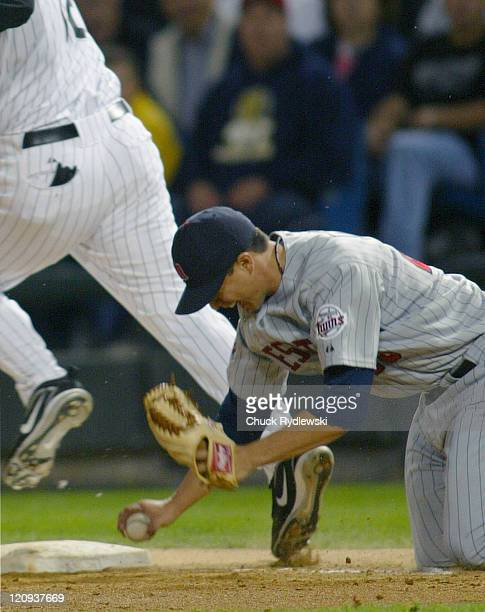 Minnesota Twins' Starter Kyle Lohse makes a diving tag of AJ Pierzynski during the game against the Chicago White Sox September 23 2005 at US...