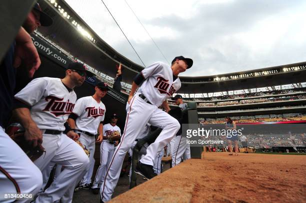 Minnesota Twins starting pitcher Kyle Gibson center and teammates take the field during the start of their Major League Baseball game against the...