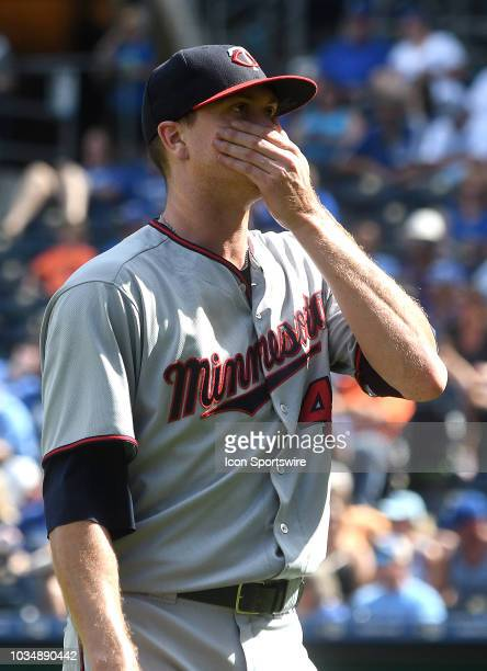Minnesota Twins starting pitcher Kyle Gibson reacts after giving up a two'run home run to Kansas City Royals shortstop Adalberto Mondesi during a MLB...