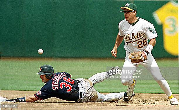 Minnesota Twins Terry Steinbach slides safely into second base as Oakland Athletics shortstop Rafael Bournigal loses the ball during the first inning...