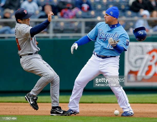 Minnesota Twins third baseman Mike Lamb bounces off Kansas City Royals first baseman Billy Butler after the two collided on a play in the fifth...