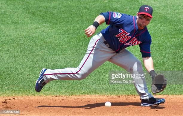 Minnesota Twins third baseman Nick Punto runs down a grounder off the bat of the Kansas City Royals' Billy Butler on Wednesday July 28 at Kauffman...