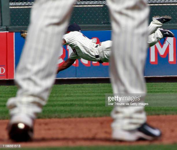 Minnesota Twins vs. Texas Rangers baseball. IN THIS PHOTO: Twins centerfielder Ben Revere chases down and catches a ball hit by Texas David Murphy in...