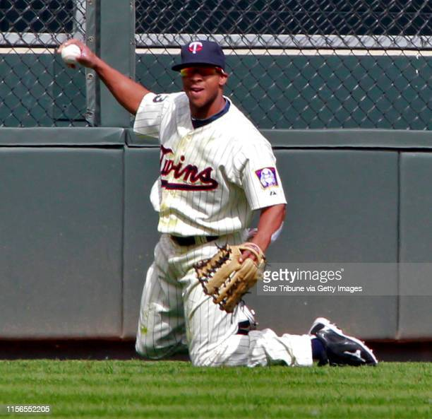 Minnesota Twins vs Texas Rangers baseball IN THIS PHOTOTwins centerfielder Ben Revere shows the ball after making a diving catch on Texas hitter...