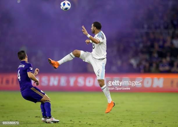 Minnesota United defender Tyrone Mears goes up for a header during the MLS Soccer match between Orlando City SC and Minnesota United FC on March 10th...