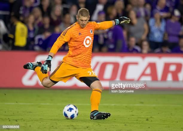 Minnesota United goalkeeper Matt Lampson punts a goal kick during the MLS Soccer match between Orlando City SC and Minnesota United FC on March 10th...