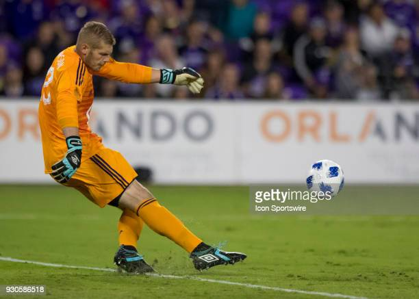 Minnesota United goalkeeper Matt Lampson punts the ball during the MLS Soccer match between Orlando City SC and Minnesota United FC on March 10th...