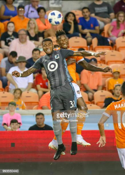 Minnesota United midfielder Alexi Gomez and Houston Dynamo forward Alberth Elis go up for a header during the soccer match between the Minnesota...