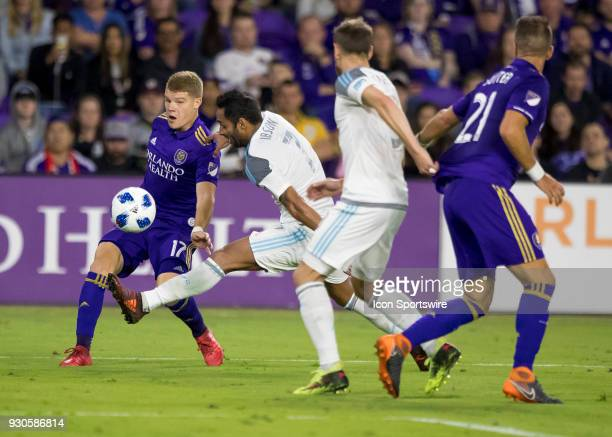 Minnesota United midfielder Ibson blocks the pass of Orlando City forward Chris Mueller during the MLS Soccer match between Orlando City SC and...