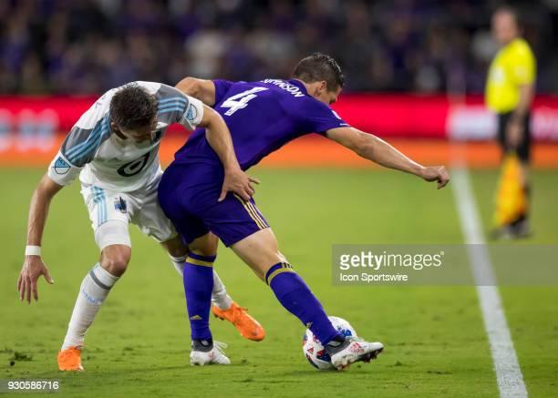 Minnesota United midfielder Sam Nicholson tangles with Orlando City midfielder Will Johnson during the MLS Soccer match between Orlando City SC and...