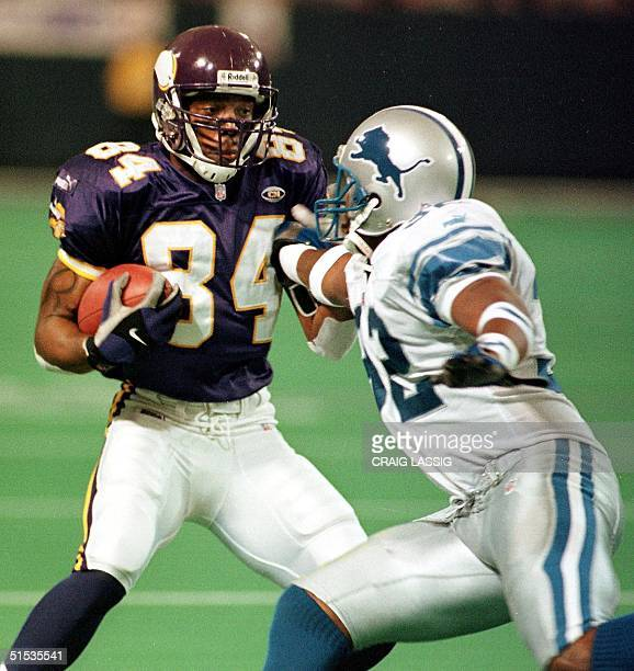 Minnesota Viking Randy Moss tries to get by Detroit Lion Bryant Westbrook after catching a pass for 17 yards to the Lions 26yard line in the 2nd...