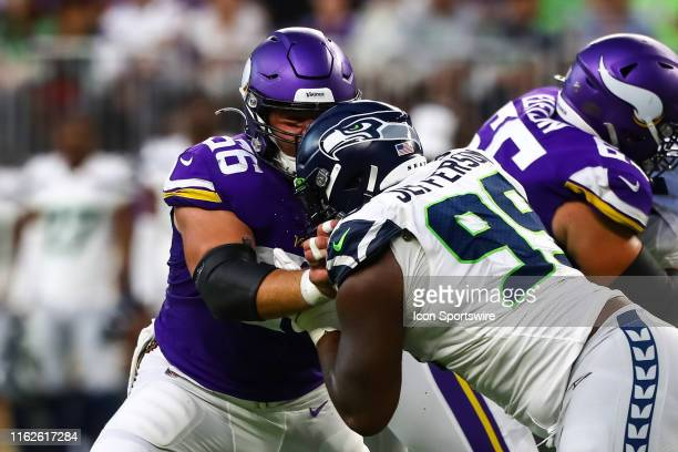 Minnesota Vikings center Garrett Bradbury blocks Seattle Seahawks defensive tackle Quinton Jefferson in the first quarter at US Bank Stadium on...
