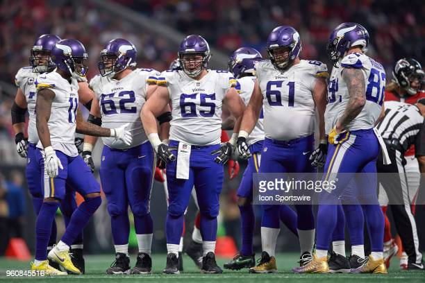 Minnesota Vikings center Pat Elflein Minnesota Vikings defensive end Ade Aruna and Minnesota Vikings center Nick Easton look on during an NFL...
