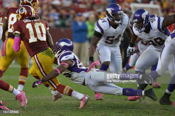 Minnesota Vikings cornerback Antoine Winfield dives and catches Washington Redskins quarterback Robert Griffin III from behind during 3rd quarter...