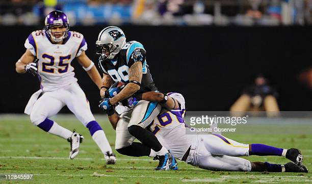 Minnesota Vikings cornerback Antoine Winfield tackles Carolina Panthers wide receiver Steve Smith after a pass reception in firstquarter action in...